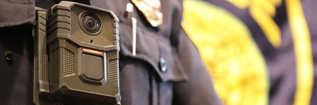Close up of a body camera worn by a police officer