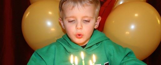 Boy Blowing Out Candles