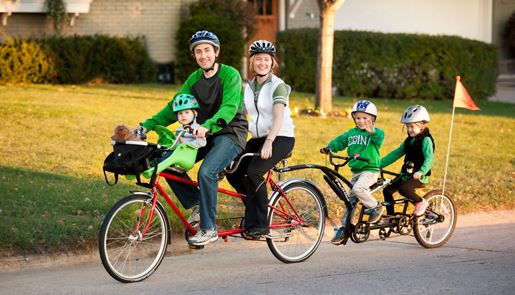 Neil and Marie Johnson and family on their mini-van bicycle