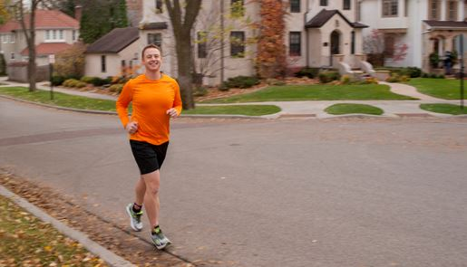Tom Kluis jogging in a neighborhood