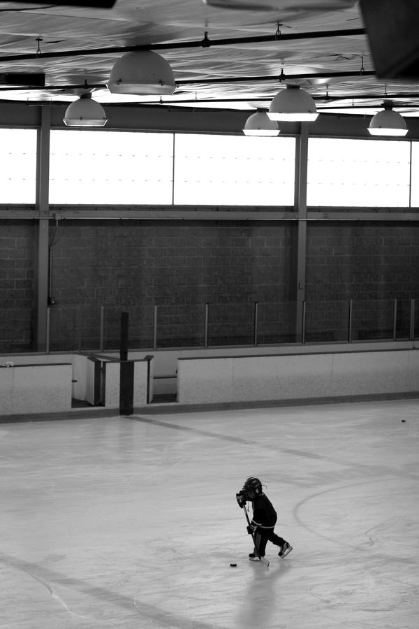 Hockey Child Player Moving Toward Puck - Aerial Shot